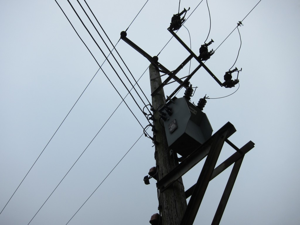 Pole-Mounted Transformer, feeding 230 volt single-phase from 11,000 volt three-phase lines.
