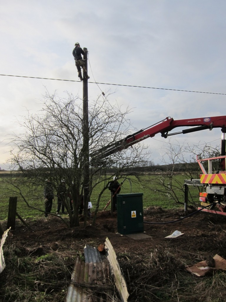 Western Power Distribution team preparing to terminate incoming electricity supply at new pole.