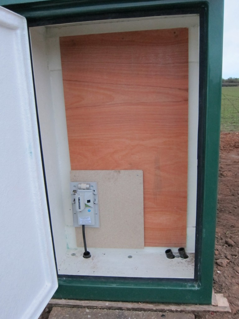 GRP cabinet with Western Power Distribution cutout installed, ready for meter.