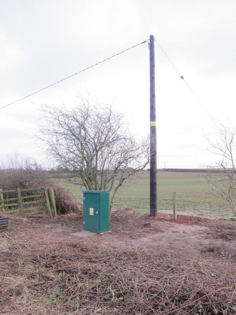 Installed GRP enclosure on concrete pad connected to new pole with incoming overhead single-phase supply.