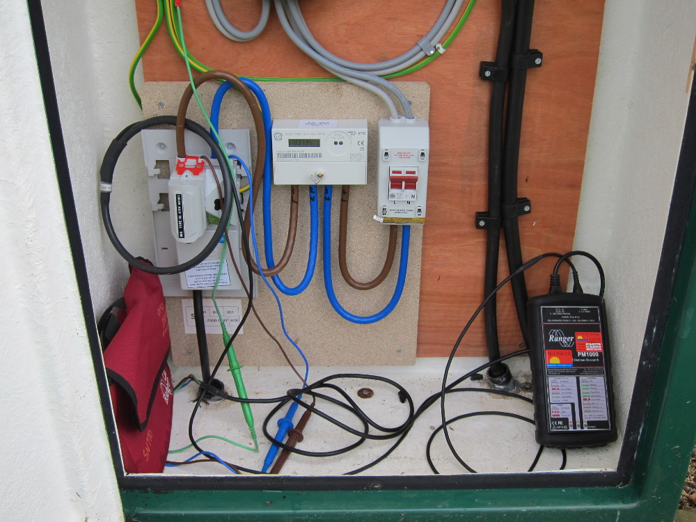 Voltage and Current data logger connected to electricity supply in GRP cabinet