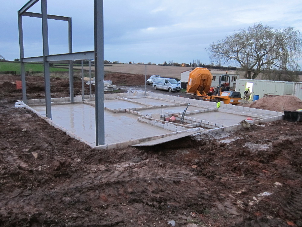 Mostly-completed oversite concrete at the end of Week 7, Day 1 - just the Shower Room and Utility Room left to complete