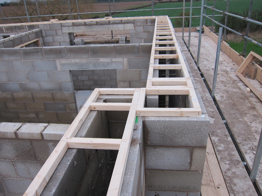 Ladder frame structure on top of cavity walls
