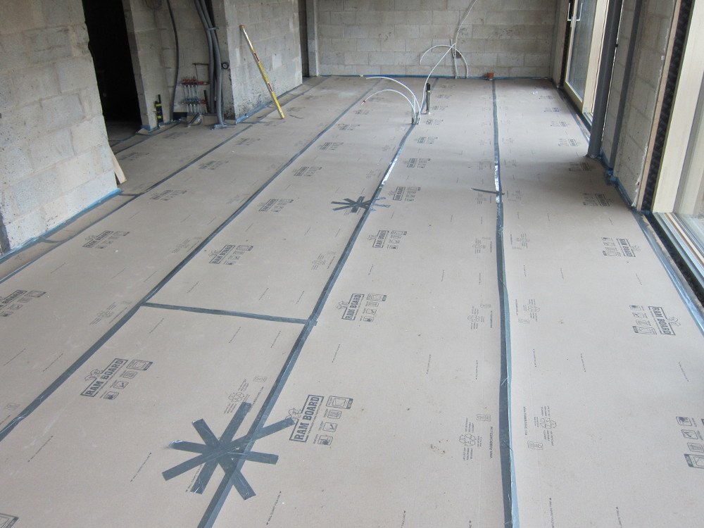 Ram Board protective cover over to-be-polished concrete floor