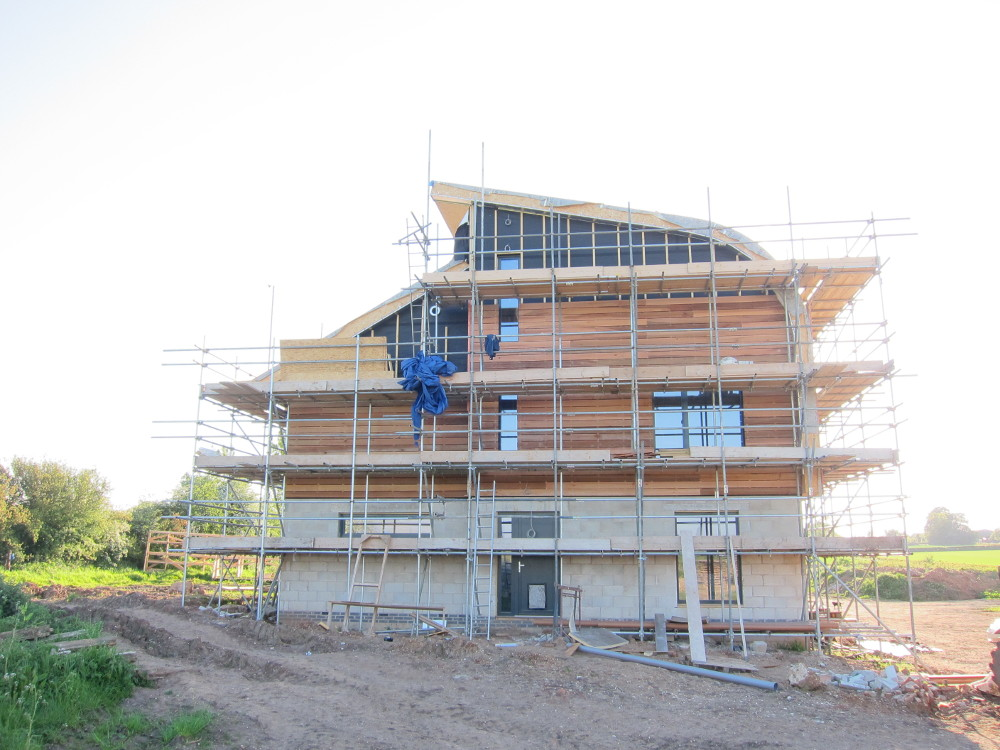 Majority of the cedar cladding now complete on the east elevation