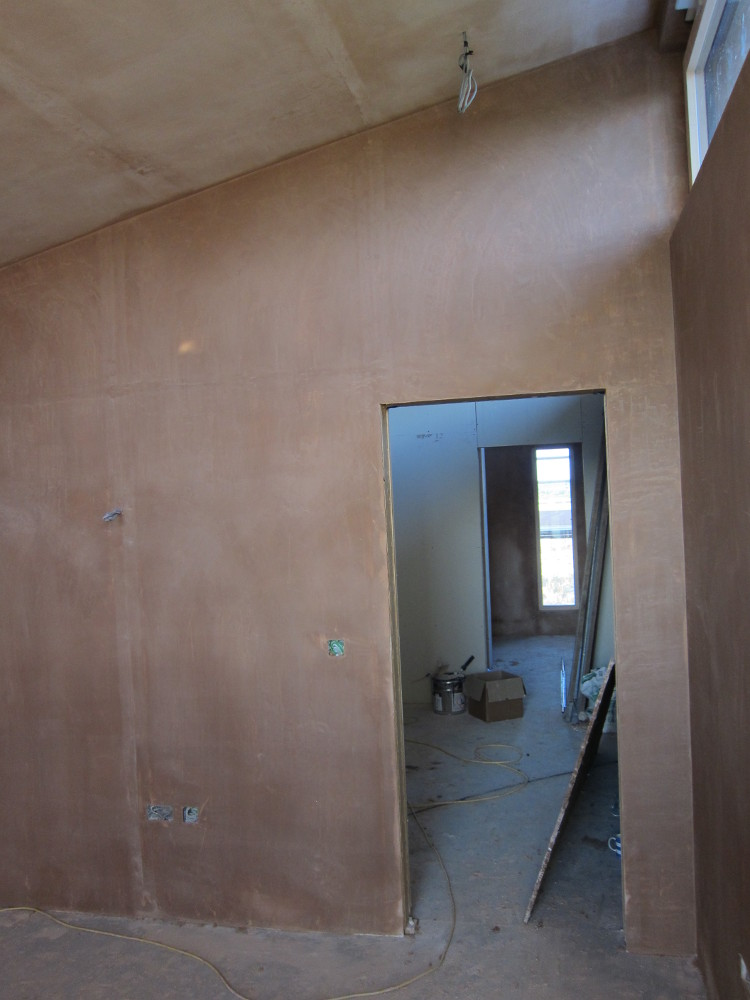 Plaster skim coat complete on the walls in the Office