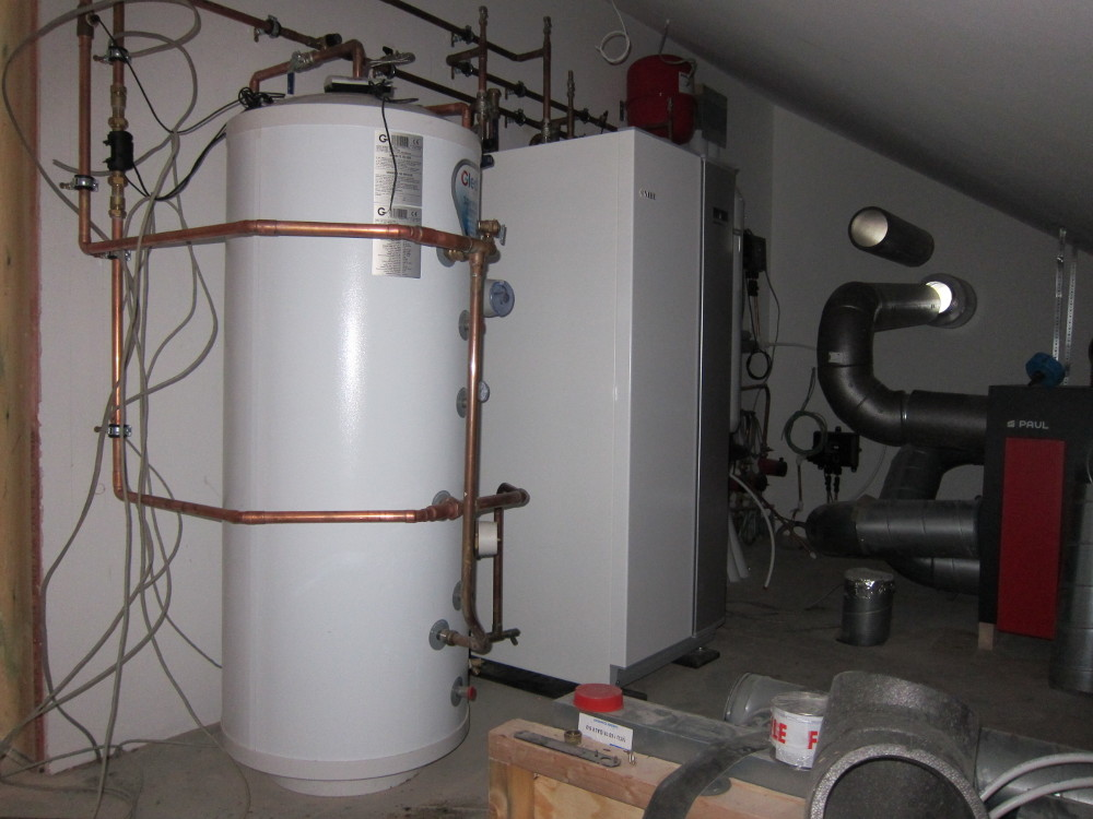 DHW tank (left) and GSHP unit (right) installed in the Plant Room