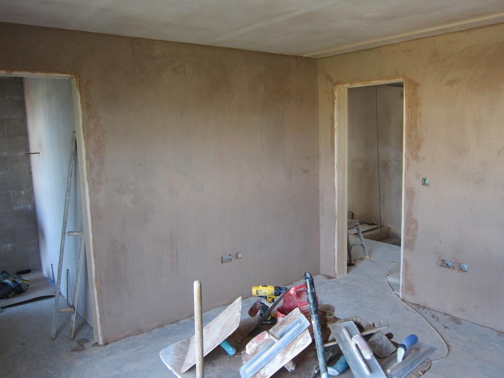 Finish coat of wet plaster on an internal masonry wall in Bedroom 3