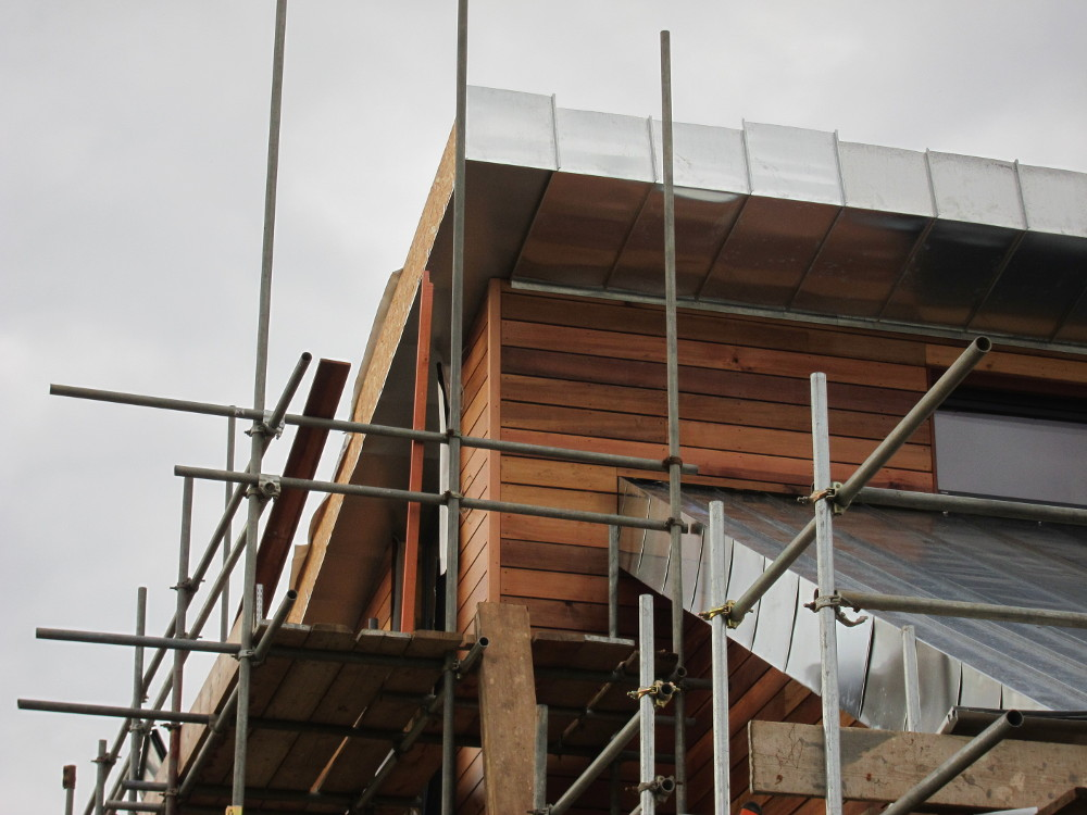 Finishing touches to the cedar cladding at the external corners