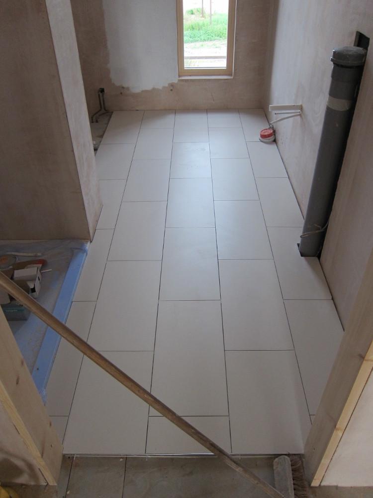 Floor tiles (without grout yet) in the Second-Floor Bathroom