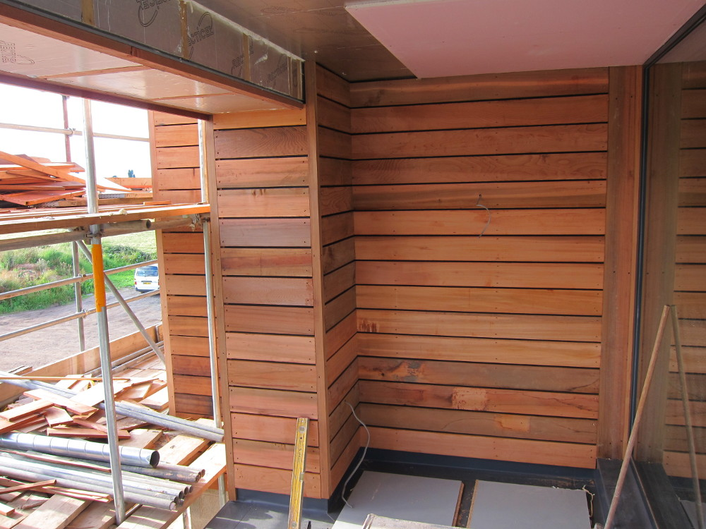 Cedar cladding around the balcony