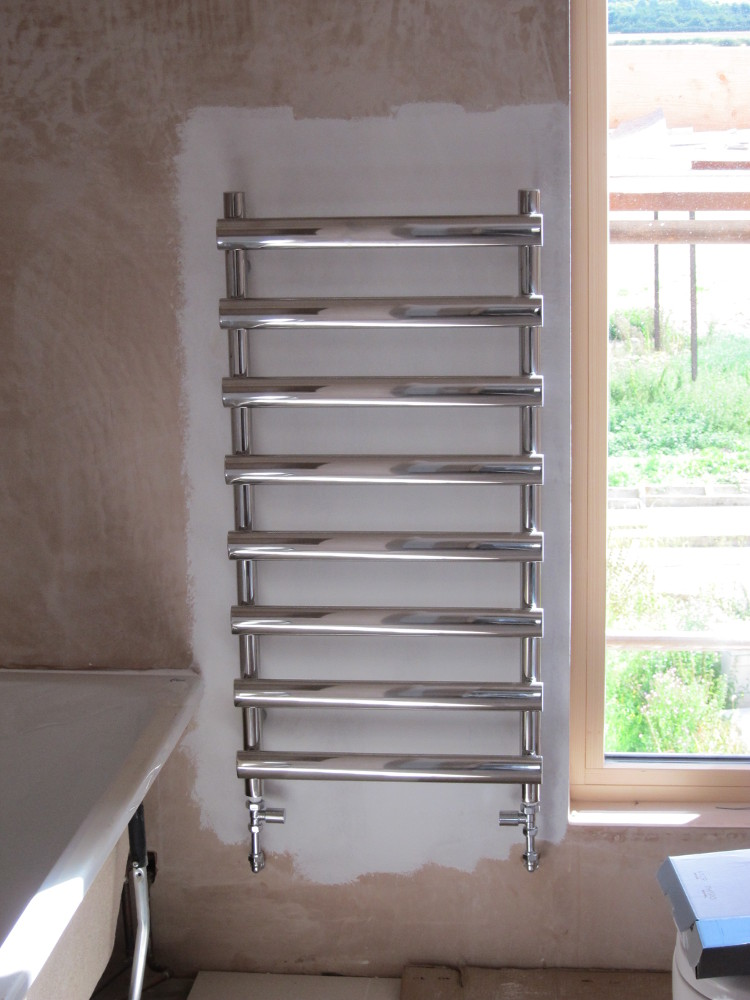 Towel radiator (one per bathroom)
