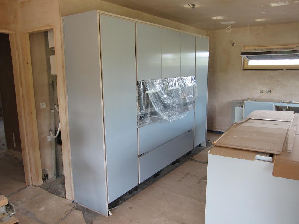 Doors installed on integrated fridge and freezer
