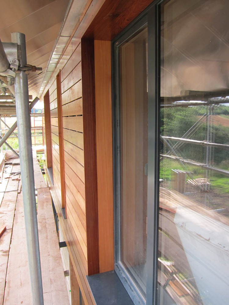 Window reveals and sills on the first floor, south side