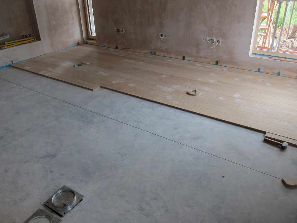 Engineered oak flooring partially completed in the Living Room
