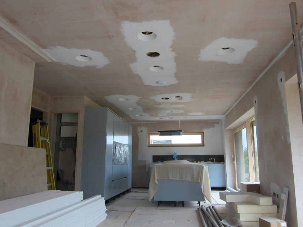 Painting around the plaster down-light surrounds in the Open Plan area