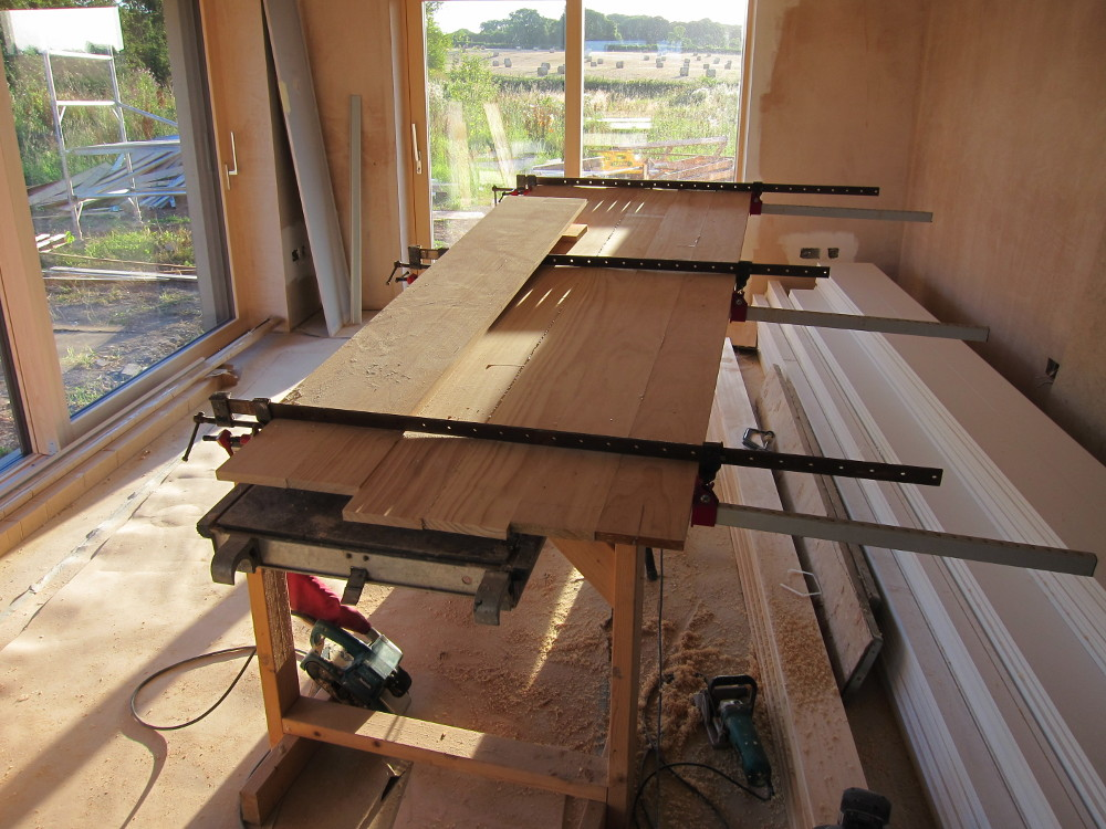 Boards being edge-glued with biscuits for the window sills