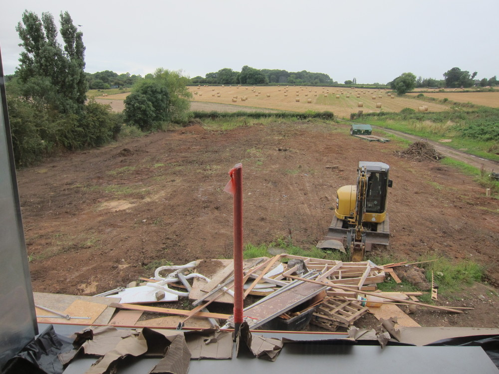 Field to west of house levelled out with the weeds scraped off