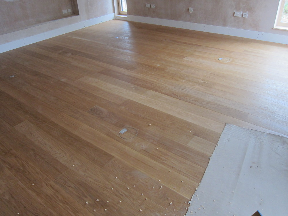 First coat of oil finish on the oak flooring in the Living Room