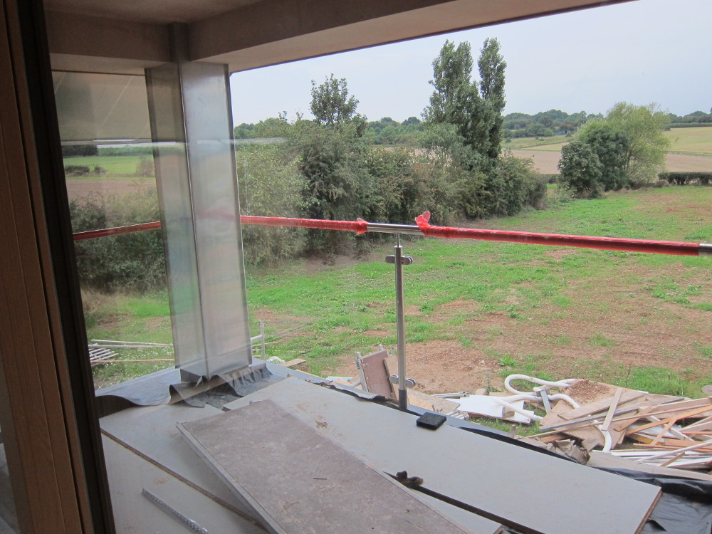 Handrail installed for balcony; just the glass to go