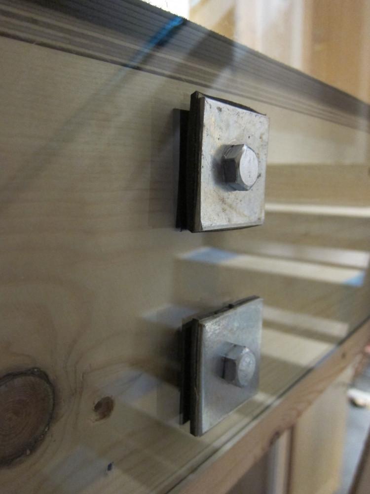 Fixings for glass balustrades on landings