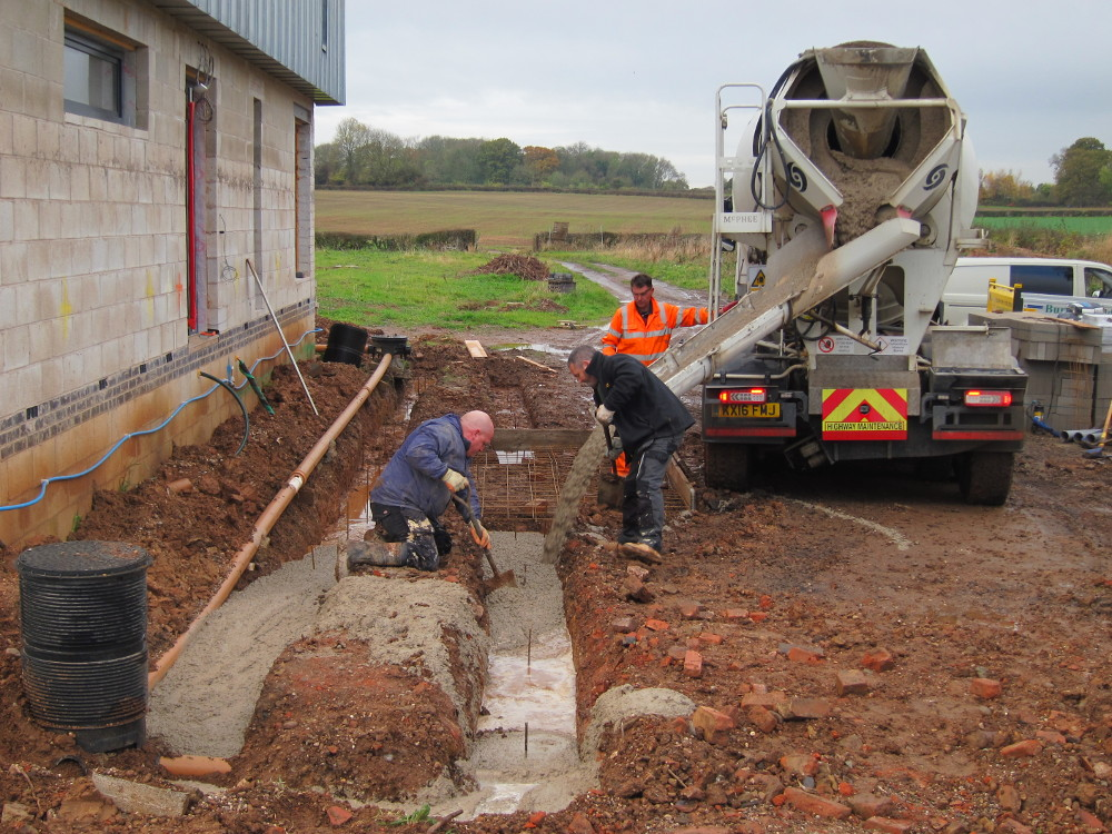 Pouring the concrete foundations for the retaining wall