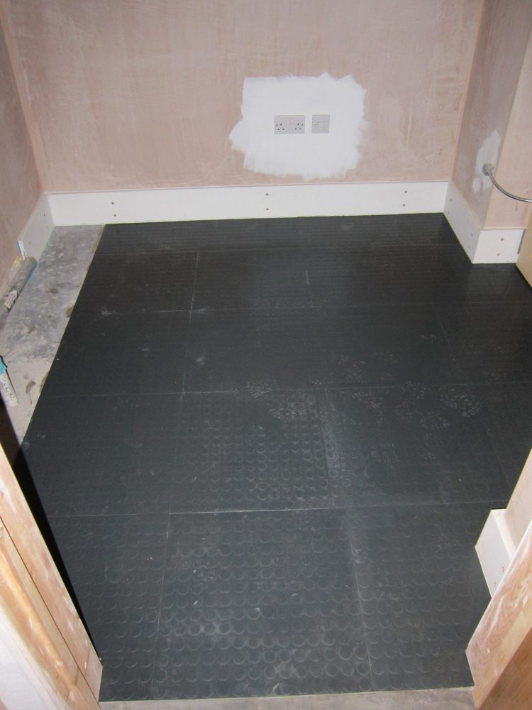 Rubber floor tiles in Utility Room